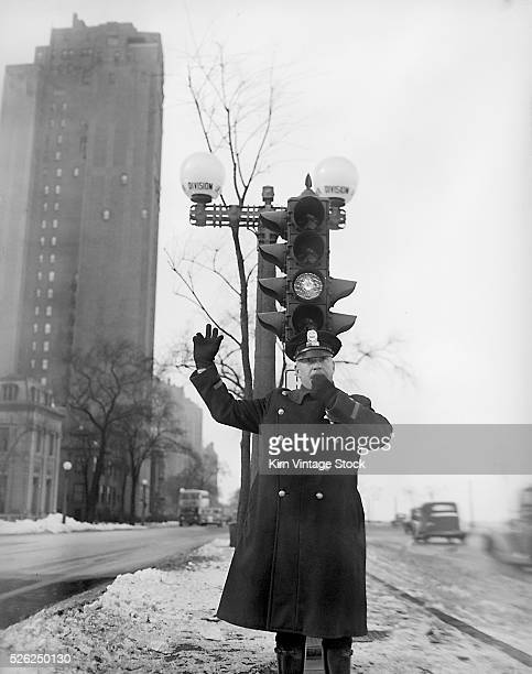 A Chicago policemen directs traffic under a stoplight along Lake Shore Drive in Chicago on a winter's day