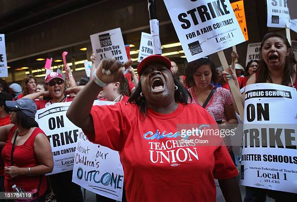 Chicago public school teachers and their supporters picket in front of the Chicago Public Schools headquarters on September 11, 2012 in Chicago,...