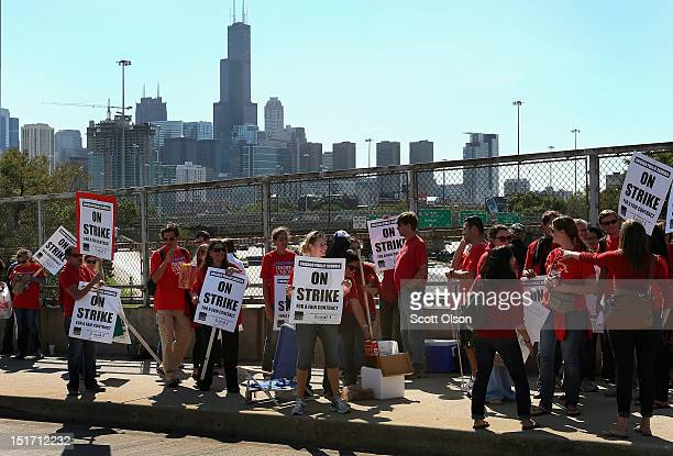 Chicago public school teachers picket on an overpass near downtown on September 10 2012 in Chicago Illinois More than 26000 teachers and support...