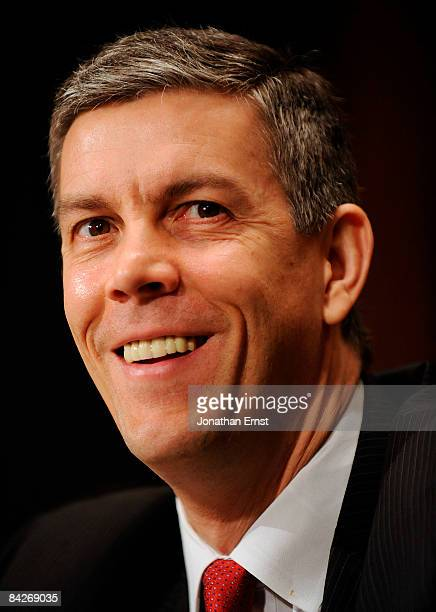 Chicago Public Schools CEO Arne Duncan, President-elect Barack Obama's designee to be Secretary of Education, smiles during his confirmation hearing...
