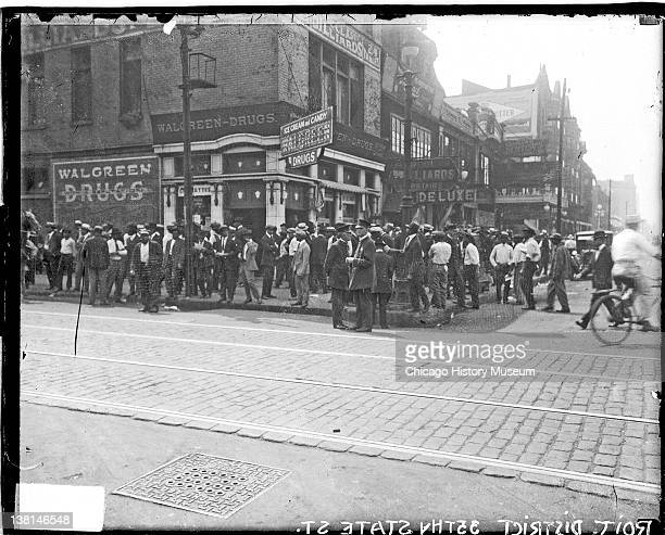 Chicago race riot African American men standing in front of Walgreen Drugs 35th and State Chicago Illinois July 30 1919