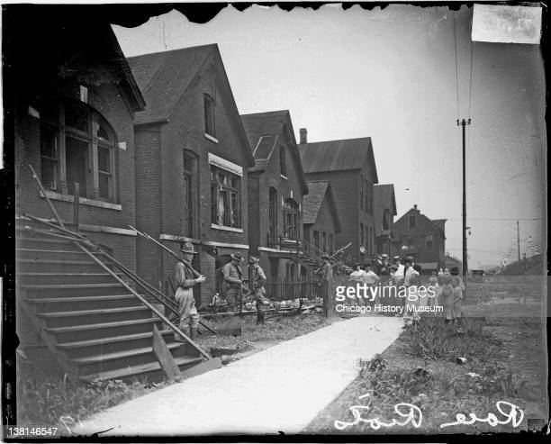 Chicago race riot soldiers with rifles standing guard at vandalized house Chicago Illinois July 30 1919