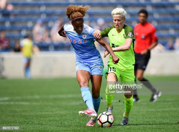 Chicago Red Stars defender Casey Short is defended by Seattle Reign FC forward Megan Rapinoe during a game between the Seattle Reign FC and the...