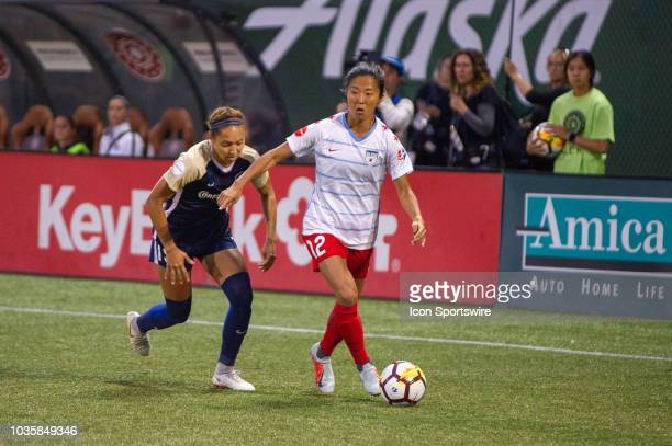 Chicago Red Stars forward Yuki Nagasato wins a ball in defense closely marked by North Carolina Courage Courage defender Jaelene Hinkle during the...