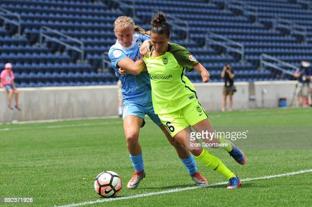 Chicago Red Stars midfielder Alyssa Mautz and Seattle Reign FC defender Carson Pickett battle for the ball in the first half during a game between...
