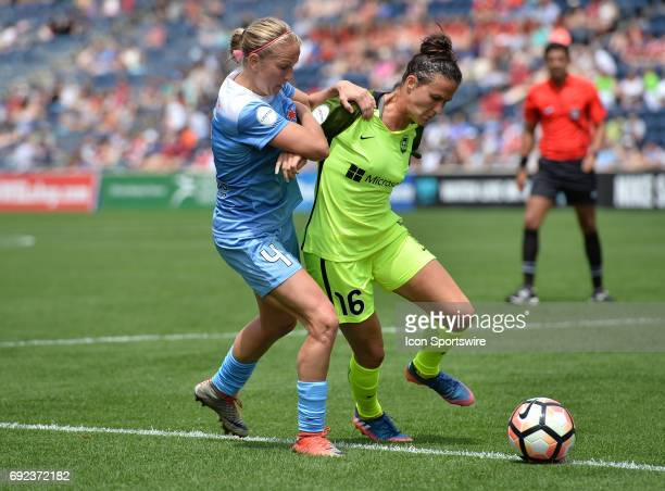 Chicago Red Stars midfielder Alyssa Mautz and Seattle Reign FC defender Carson Pickett vie for the ball during a game between the Seattle Reign FC...