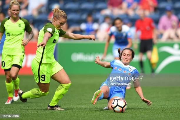 Chicago Red Stars midfielder Danielle Colaprico slides into the ball against Seattle Reign FC midfielder Merritt Mathias in the second half during a...