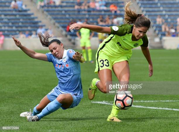 Chicago Red Stars midfielder Vanessa DiBernardo and Seattle Reign FC forward Katlyn Johnson vie for the ball during a game between the Seattle Reign...