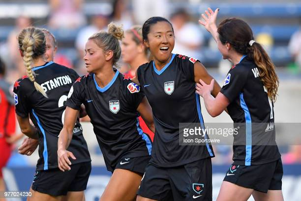 Chicago Red Stars's Yki Nagasato celebrates with teammates after scoring a goal against the Portland Thorns FC on June 16 2018 at Toyota Park in...