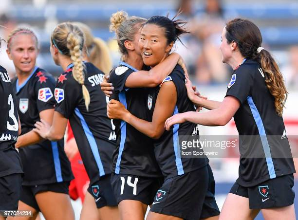 Chicago Red Stars's Yki Nagasato is embraced by Chicago Red Stars's Sarah Gorden after scoring a goal against the Portland Thorns FC on June 16 2018...