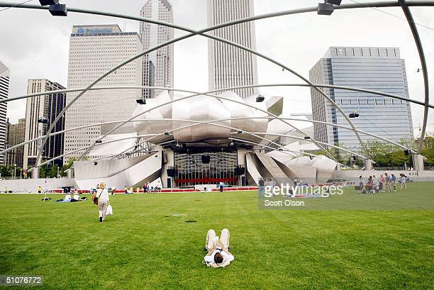 Chicago residents and tourists explore the Pritzker Pavilion designed by famed architect Frank Gehry in the newly opened Millennium park July 16 2004...