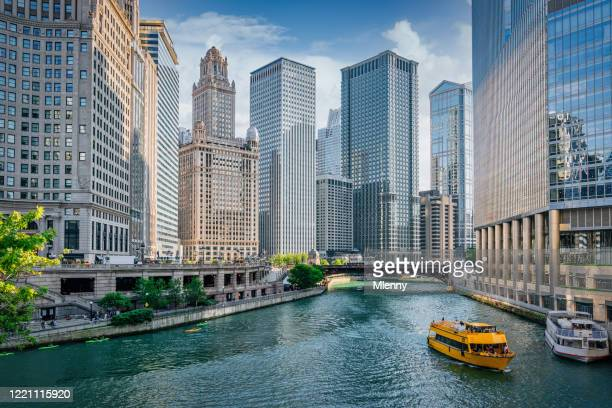 chicago river cityscape water taxi tourboat cruising in summer - chicago illinois stock pictures, royalty-free photos & images