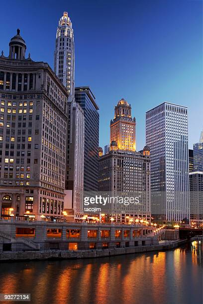 chicago river illuminated by city lights in late afternoon - san antonio stock photos and pictures