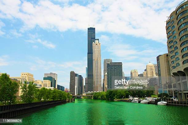 chicago river which is dyed green for st. patrick`s day, chicago, ilinois, us - chicago river stock pictures, royalty-free photos & images