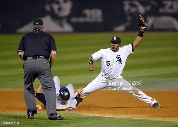 Chicago shortstop Juan Uribe gets the call on a force out at second base of Kansas City first baseman Mike Sweeney as the Kansas City Royals play the...