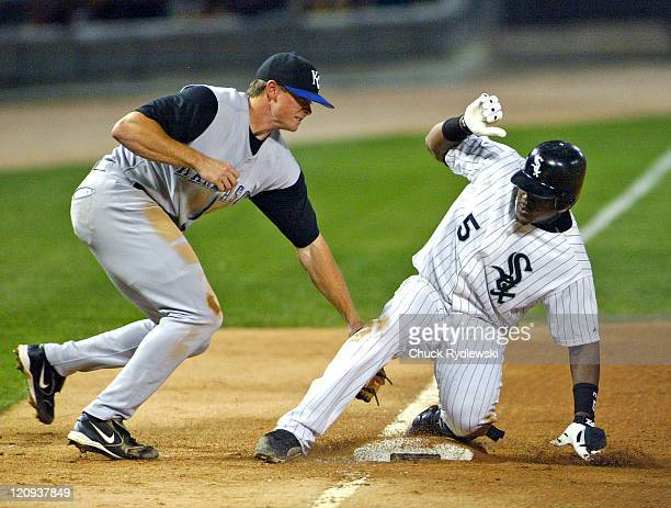 Chicago shortstop Juan Uribe slides safely into third base with a triple as the Kansas City Royals play the the Chicago White Sox at U.S. Cellular...