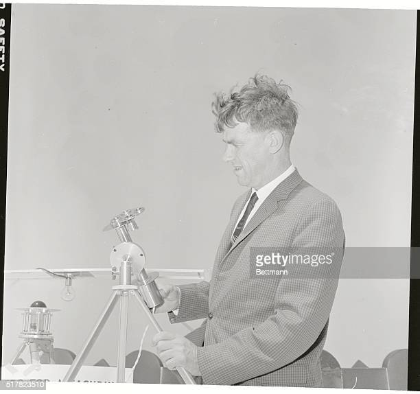 Sir Edmund Hillary British conqueror of Mt Everest inspects an instrument he will take on expedition later this year to Mt Makalu in Himalayas Device...