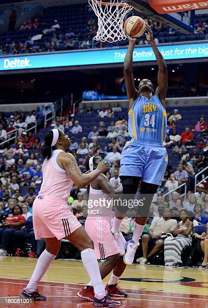 Chicago Sky center Sylvia Fowles scores on a lob pass from Sky forward Tamera Young over Washington Mystics center Kia Vaughn and Mystics guard Matee...