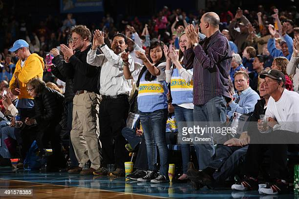 Chicago Sky fans cheer on their team during a timeout in the game against the Indiana Fever on May 16 2014 at Allstate Arena in Rosemont Illinois...
