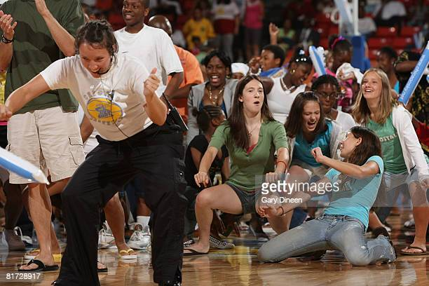 Chicago Sky fans participate in the Cha Cha Slide during a time out in the WNBA game against the Phoenix Mercury at the UIC Pavilion June 26 2008 in...