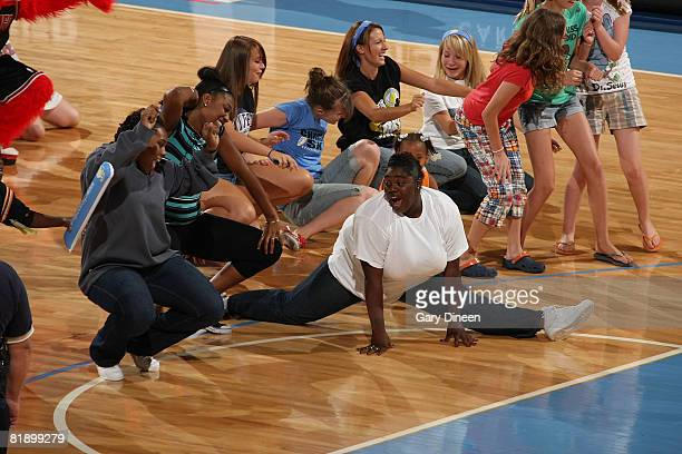 Chicago Sky fans participate in the Cha Cha Slide during a time out in the WNBA game against the San Antonio Silver Spurs on July 10 2008 at the UIC...