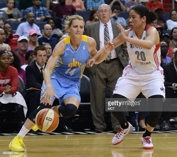 Chicago Sky guard Allie Quigley dribbles against Washington Mystics guard Kara Lawson in the third quarter at the Verizon Center in Washington Friday...