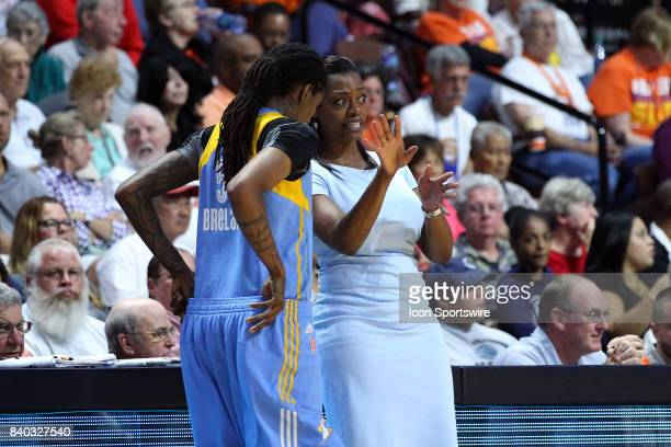 Chicago Sky head coach Amber Stocks speaks with Chicago Sky forward Jessica Breland during the first half of an WNBA game between Chicago Sky and...