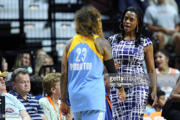 Chicago Sky head coach Amber Stocks speaks with Chicago Sky guard Cappie Pondexter during the first half of an WNBA game between Chicago Sky and...
