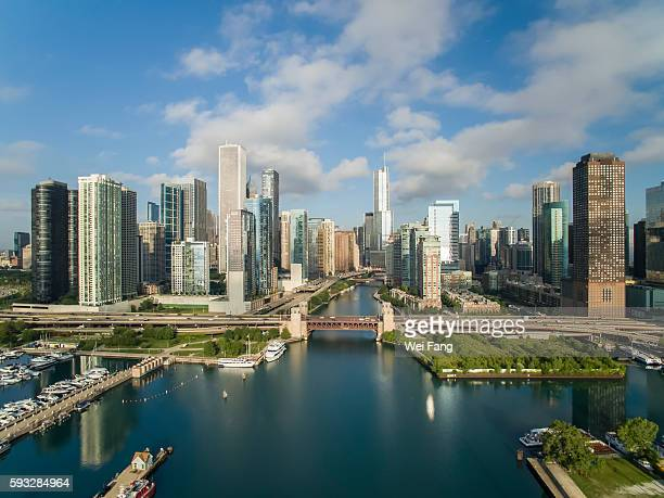 chicago skyline along chicago river - chicago river stock pictures, royalty-free photos & images