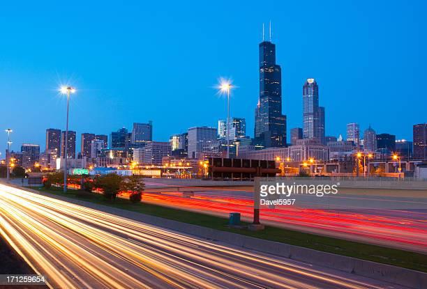 Chicago skyline and freeway at dusk