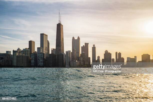 chicago skyline at sunset time - chicago stock pictures, royalty-free photos & images