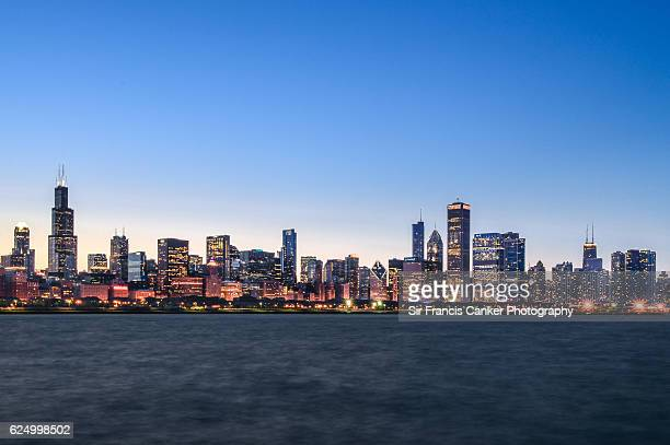 Chicago skyline illuminated at dusk with lake Michigan waterfront, Illinois, USA