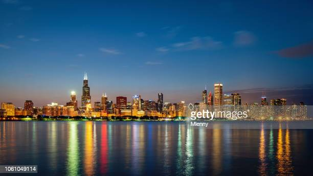 chicago skyline panorama lake michigan reflections at night - urban skyline stock pictures, royalty-free photos & images