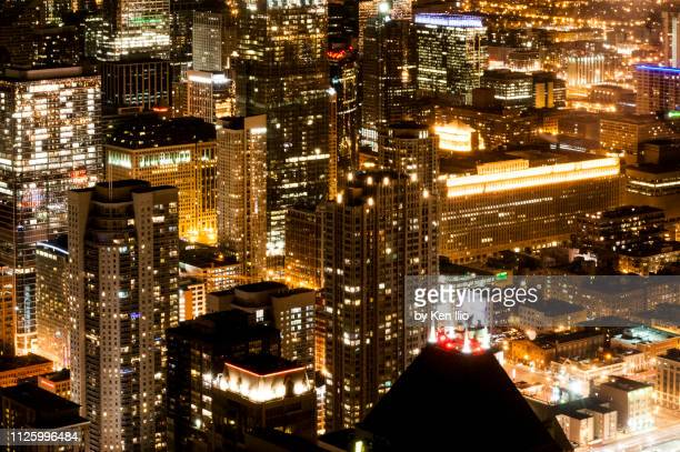 chicago skyscrapers at night - ken ilio stock photos and pictures