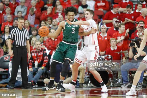 Chicago State center Deionte Simmons tries to get past Wisconsin forward Nate Reuvers during a college basketball game between the University of...
