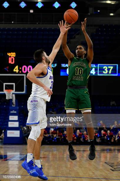 Chicago State Cougars guard Anthony Harris shoots against DePaul Blue Demons guard Max Strus on December 12 2018 at the Wintrust Arena in Chicago...