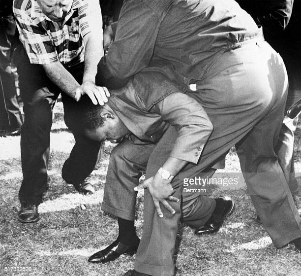 Struck on the head by a rock thrown by a group of hecklers Dr Martin Luther King falls to one knee Dr King regained his feet and led a group of...