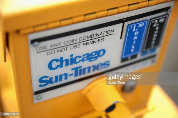 Chicago Sun Times newspapers are sold from of a dispenser near their editorial offices on May 15 2017 in Chicago Illinois Tronc the parent company of...