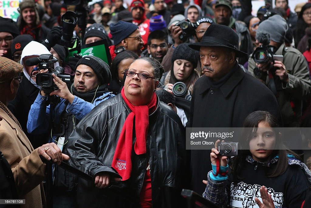 Chicago Teachers Union President Karen Lewis (C) and Rev. Jesse Jackson prepare to speak to demonstrators protesting school closings on March 27, 2013 in Chicago, Illinois. About 2,000 protestors held a rally and marched through downtown to protest a plan by the city to close more than 50 elementary schools, claiming it is necessary to rein in a looming $1 billion budget deficit. The closings would shift about 30,000 students to new schools and leave more than 1,000 teachers with uncertain futures.