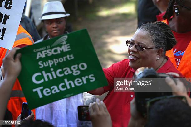 Chicago Teachers Union President Karen Lewis greets supporters during a rally at Union Park September 15 2012 in Chicago Illinois An estimated 25000...