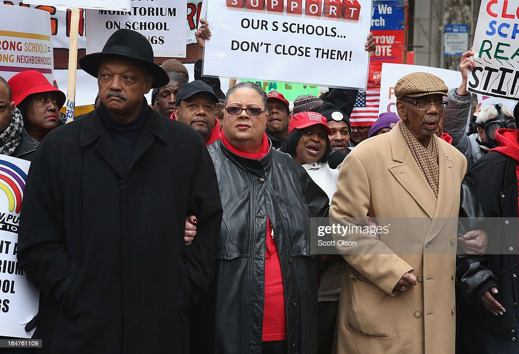 Chicago Teachers Union President Karen Lewis (C), Rev. Jesse Jackson (L) and Congressman Bobby Rush (D-IL) march with demonstrators protesting school closings on March 27, 2013 in Chicago, Illinois. About 2,000 protestors held a rally and marched through downtown to protest a plan by the city to close more than 50 elementary schools, claiming it is necessary to rein in a looming $1 billion budget deficit. The closings would shift about 30,000 students to new schools and leave more than 1,000 teachers with uncertain futures.