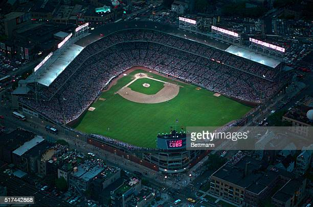 The lights are switched on at Wrigley Field as the Cubs host the Phillies in the first night game ever at the ballpark The lights ended a 72year...