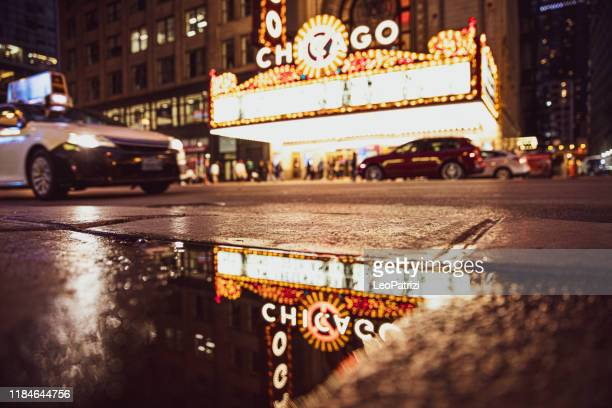 chicago theater and historical buildings district in city downtown - chicago theater stock pictures, royalty-free photos & images