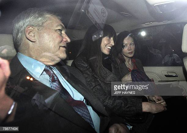 Deposed media tycoon Conrad Black sits in car after leaving the US District Federal courthouse with daughter Alana and wife Barbara Amiel Black after...