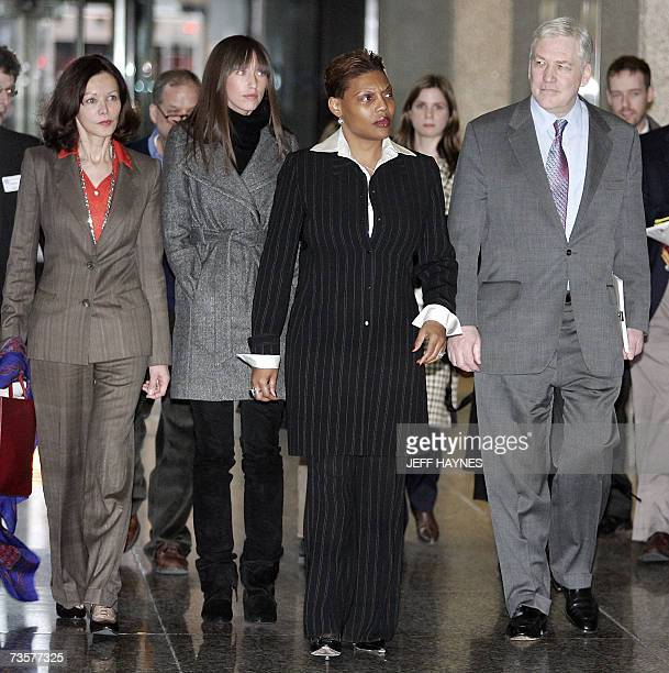 Deposed media tycoon Conrad Black walks out of the US District Federal courthouse with daughter Alana wife Barbara Amiel Black and an unidentified...
