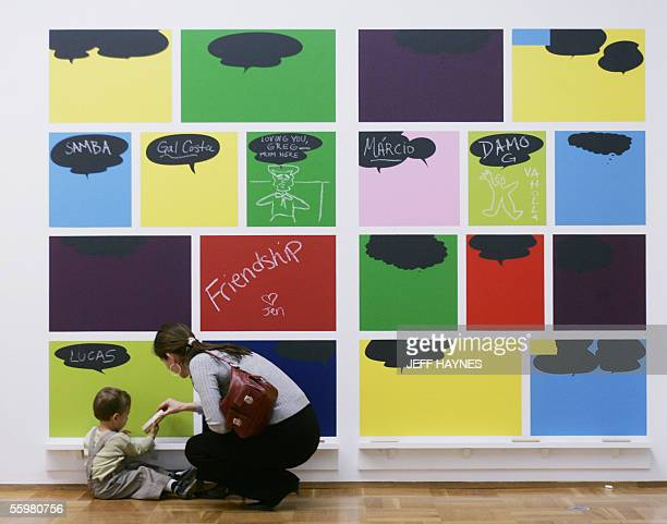 Lucas 18 months old and his mother Monica Amor Museum of Contemporary Art curator play with Ze Carioca e Amigos and Friends by Rivane Neuenschwander...