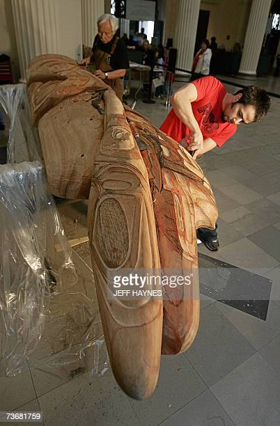Native American and master carver Nathan Jackson and son Stephen Jackson work together on the new totem pole they were commissioned to build by the...