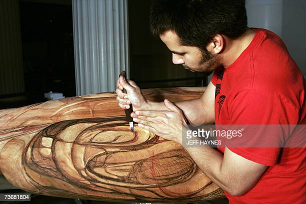 Stephen Jackson carves part of the new totem pole he and his father Native American and master carver Nathan Jackson where commissioned to build by...