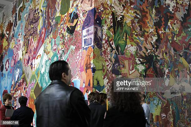Visitors look over assume vivid astro focus during the preview for Tropicalia A Revolution in Brazilian Culture at the Museum of Contemporary Art in...