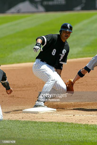 Chicago White Sox' 2nd Baseman Alex Cintron slides safely into 3rd base with a 1st inning triple during their game against the Detroit Tigers August...